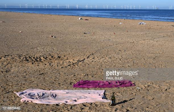 Litter is strewn over Formby beach near Liverpool, northwest England on June 1, 2020.