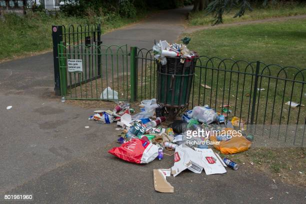 Litter overspill of beer cans and general rubbish overspilled from a public park bin on 23rd June 2017 Ruskin Park south London borough of Lambeth