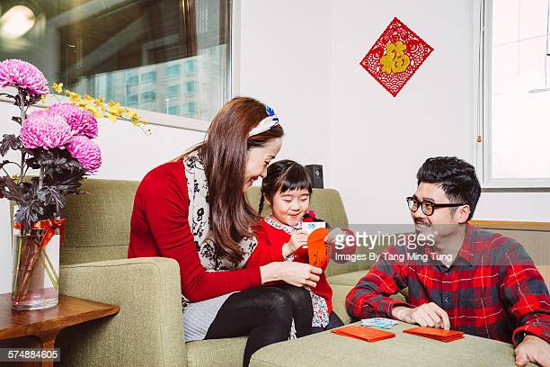 Littl girl preparing Chinese New Year with parent