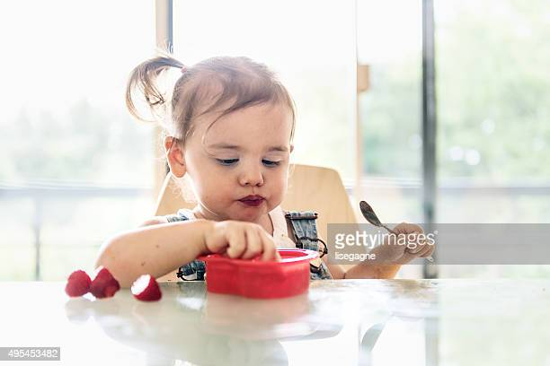 little 2 years old girl eating jello - toddler stock pictures, royalty-free photos & images