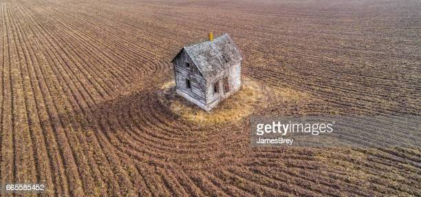 little, abandoned, old house on an island in time. - abandoned stock pictures, royalty-free photos & images