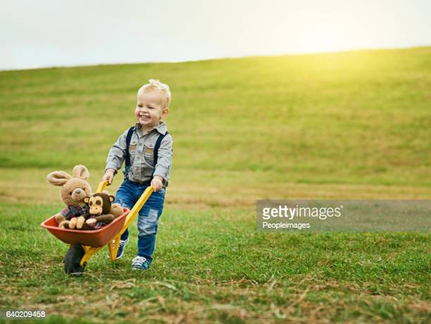 little adventures on a big farm - wheelbarrow stock photos and pictures