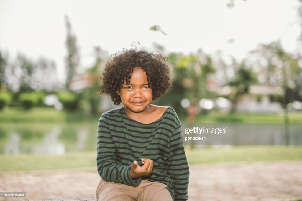 little African american boy crying : Stock Photo
