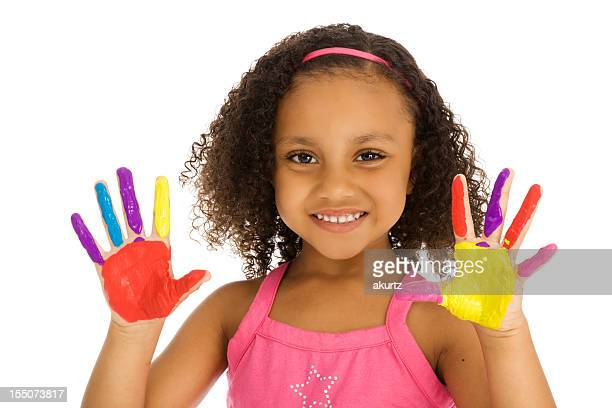 Little African American girl playing with finger paint