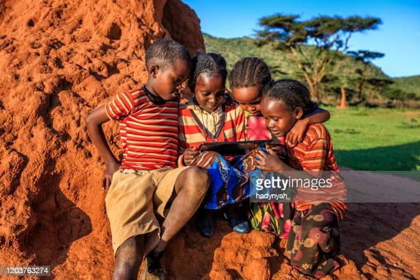 little african children using digital tablet, east africa - developing countries stock pictures, royalty-free photos & images
