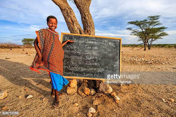 Little African girl during English class, East Africa