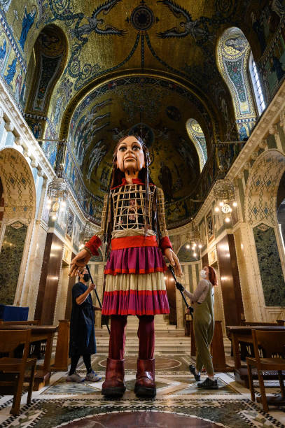 GBR: Little Amal, The Migrant Puppet, Visits Westminster Cathedral