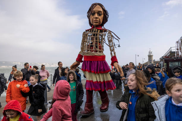 GBR: 'Little Amal', Migrant Puppet Traversing Europe, Arrives In England