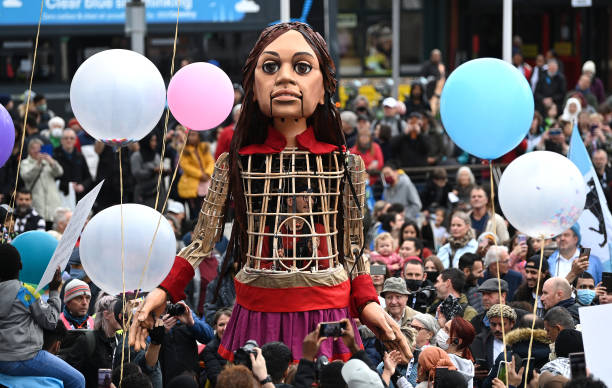 GBR: Little Amal Visits Coventry City Of Culture 2021: The Walk