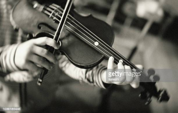 a little anne-sophie is practicing on her violin - violin stock pictures, royalty-free photos & images