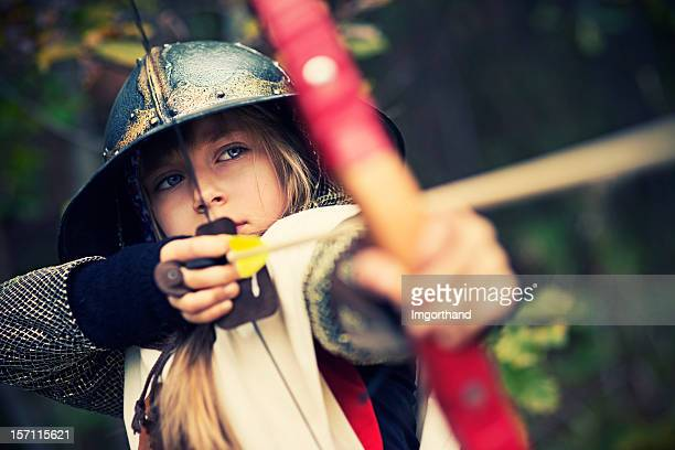 little archer in woods - acting stock pictures, royalty-free photos & images