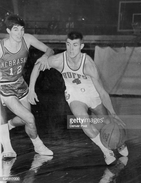 Little Arm Guarding Doesn't Bother Gordie Gordie Tope of Colorado drives to the baseline Saturday night with Sam Martin Nebraska guard grabbing at...