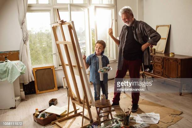 little artist and grandpa - easel stock pictures, royalty-free photos & images