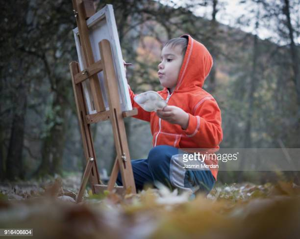 Little artist drawing in nature