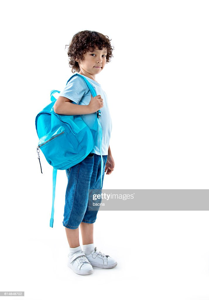 Little asian boy with schoolbag against white background : Foto de stock