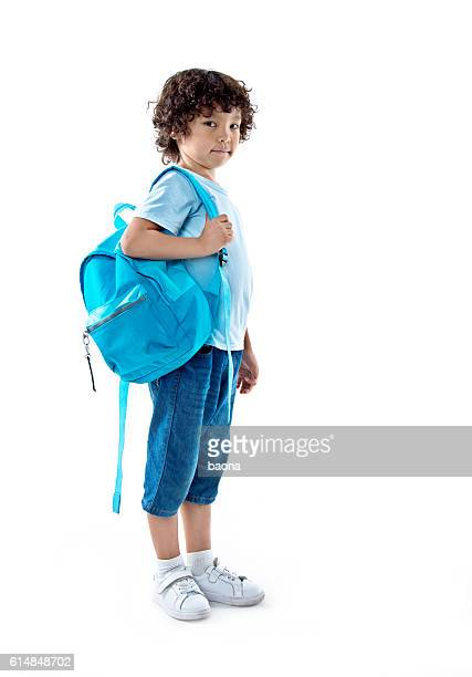 98f0bb1ff6 Little asian boy with schoolbag against white background