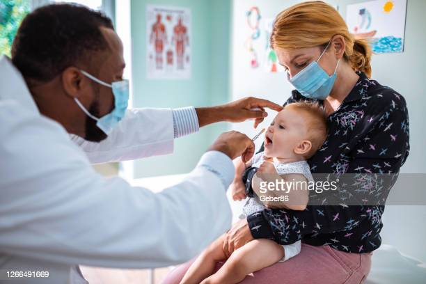 little baby getting vaccinated - cold and flu stock pictures, royalty-free photos & images