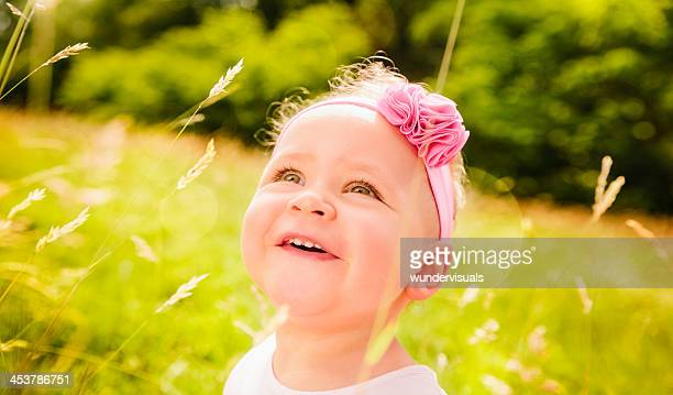Little Baby girl in nature looking at copy space