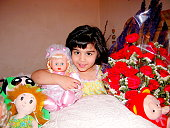 little baby girl with her doll