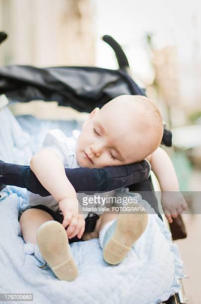 Little baby sleeps in the street