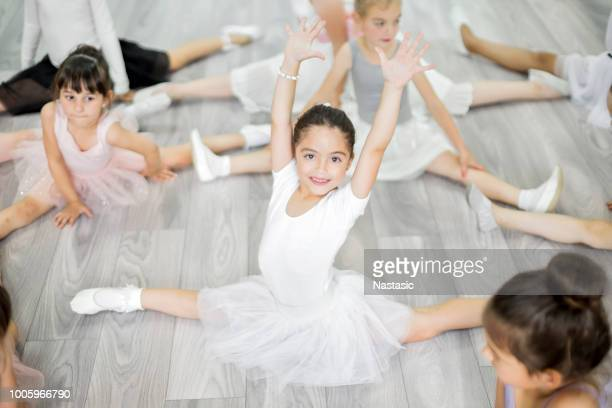 little ballerina girls stretching in studio - ballet stock pictures, royalty-free photos & images