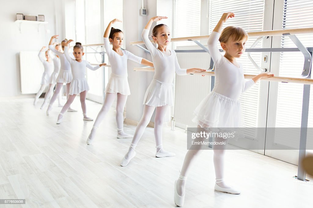 Little Ballerinas Using Barre While Practicing In Dance Studio Foto De Stock Getty Images