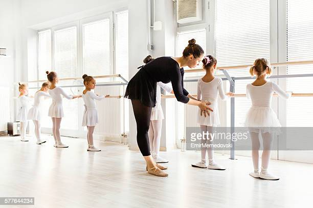 little ballerinas with personal ballet teacher in dance studio. - mini skirt stock photos and pictures