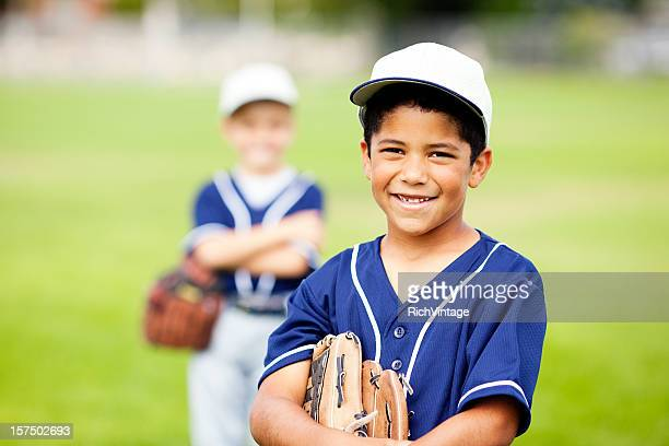 little baseball players - baseball uniform stock pictures, royalty-free photos & images