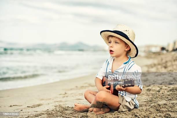Little beach guitarist.