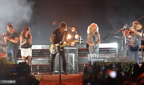Little Big Town joins Keith Urban and performs at Country Thunder Twin Lakes Wisconsin Day 2 on July 19 2013 in Twin Lakes Wisconsin
