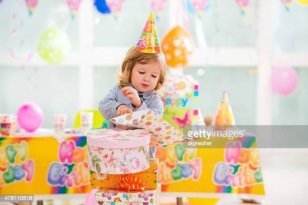Little birthday boy with birthday presents.