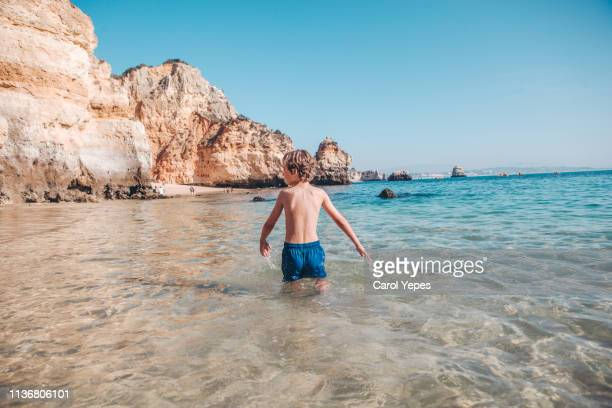 little blonde boy having at beach - faro stock pictures, royalty-free photos & images