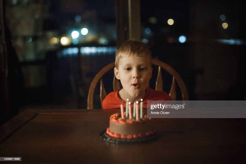 Little blowing out candles : Stock Photo