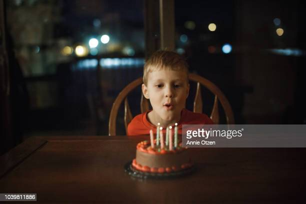 little blowing out candles - birthday cake stock pictures, royalty-free photos & images