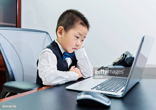 little boss - adult imitation stock pictures, royalty-free photos & images