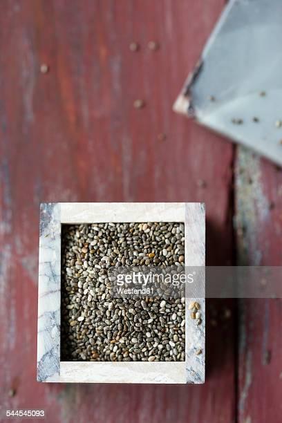 Little box of chia, Salvia hispanica, on wood