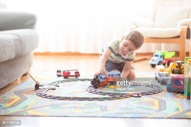 little boy, 3-4 years, playing with train and toys at home - 4 5 years stock pictures, royalty-free photos & images