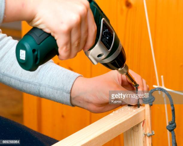 Little Boy Age 7 Years Using Power Tool - Electric Drill