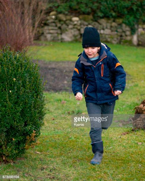 little boy age 8 years running in garden - 8 9 years stock pictures, royalty-free photos & images