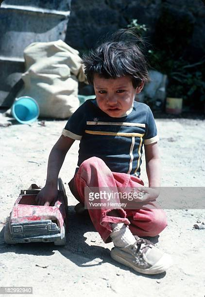 A little boy alone with his brother at home plays outside his house September 4 1982 in Santa Catarina Mexico Poverty is prevalent in Santa Catarina