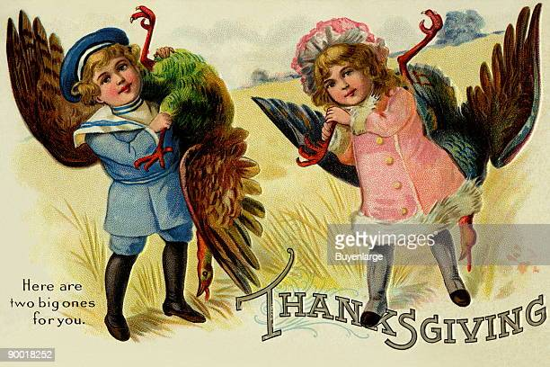 A little boy and a little girl have captures and brought two large turkeys as a gift This vintage postcard was mailed for Thanksgiving
