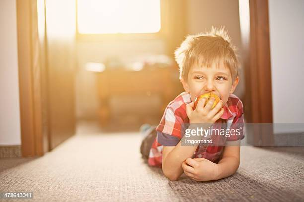 Little boy and apple