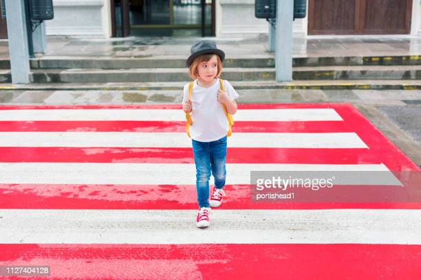 little boy and crosswalk - strisce pedonali foto e immagini stock