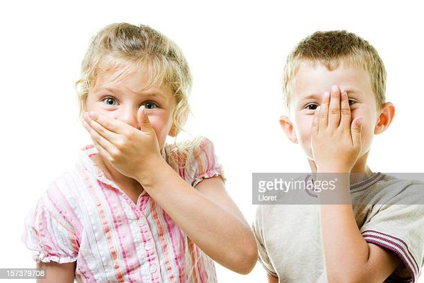 Little Boy and Girl covering mouth
