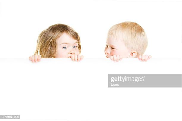 Little boy and girl holding blank sign