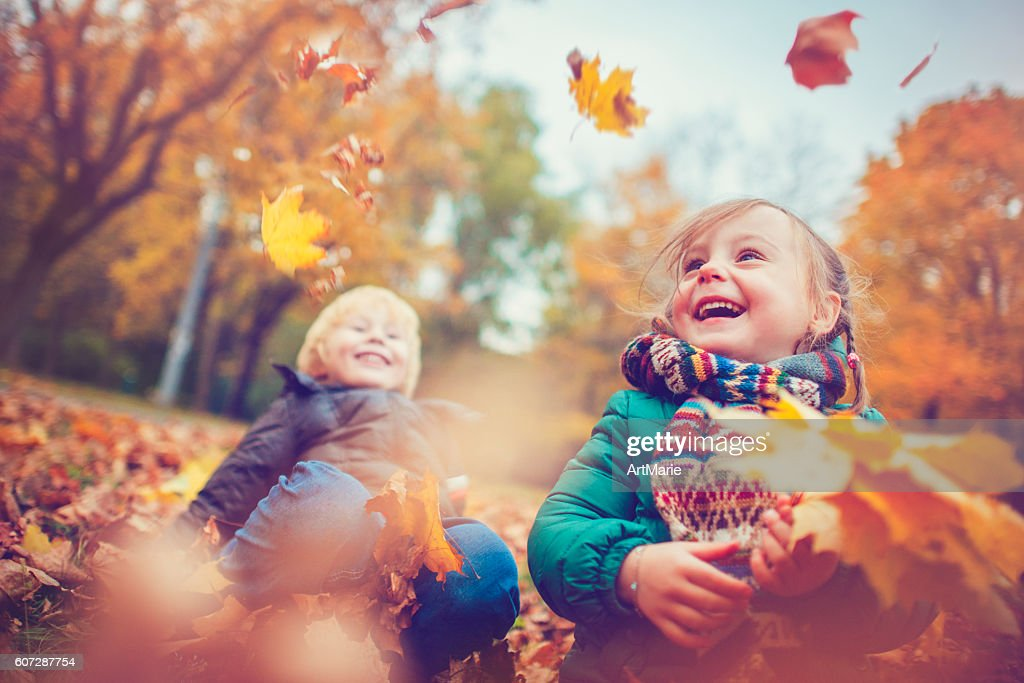 Little boy and girl in autumn park : Stock Photo