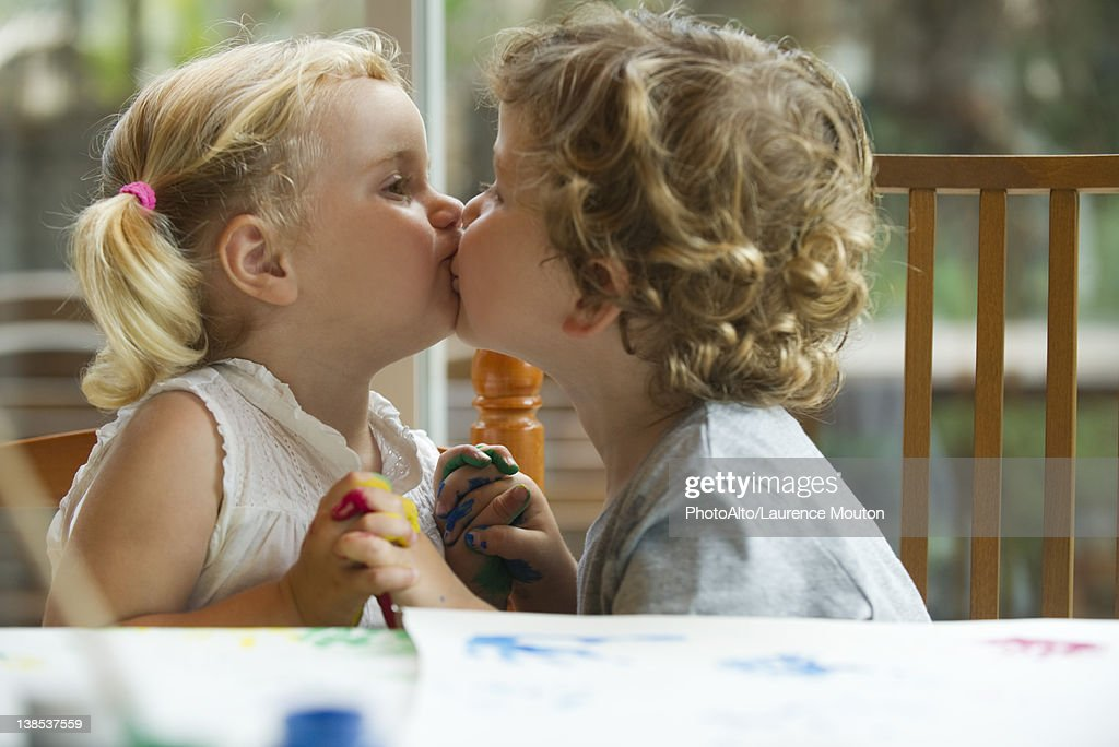 Little boy and girl kissing stock photo getty images little boy and girl kissing stock photo thecheapjerseys