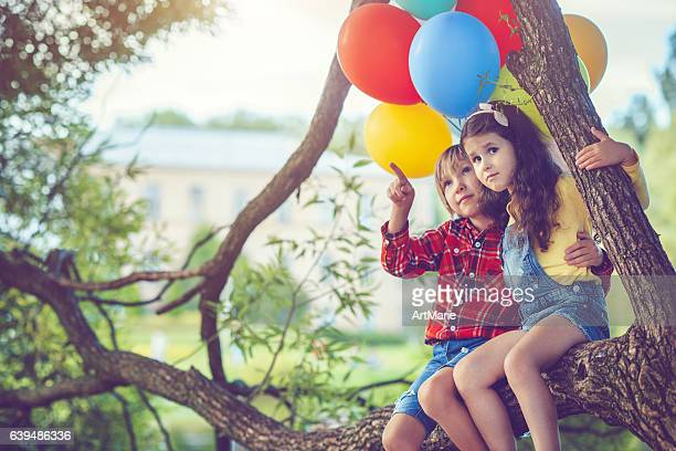 Little boy and girl with balloons