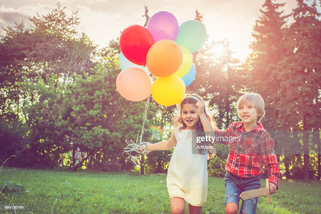 Little boy and girl with balloons : Stock Photo