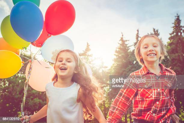 little boy and girl with balloons - little russian girls stock photos and pictures